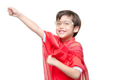 Little boy is dressed up as a superhero flying Royalty Free Stock Images