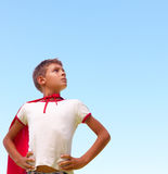 Little boy dressed up as a superhero looking away Stock Photos