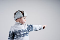 Little boy dressed in winter clothes Stock Photos