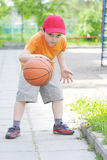 Little boy dribbling basketball Royalty Free Stock Photography