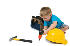 Little Boy Drilling stock photo
