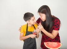 Little boys blend water melone juice by using blender home royalty free stock images