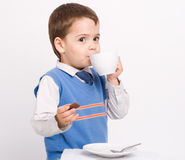 Little boy drinking Royalty Free Stock Image