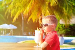 Little boy drinking cocktail on tropical beach Stock Photo