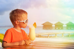 Little boy drinking cocktail on tropical vacation Royalty Free Stock Photos