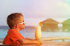Little boy drinking cocktail on tropical vacation Stock Photos