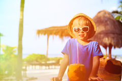 Little boy drinking coconut cocktail on the beach Royalty Free Stock Image