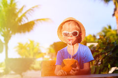 Little boy drinking coconut cocktail on the beach Royalty Free Stock Images
