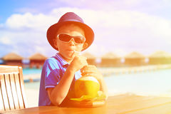 Little boy drinking coconut cocktail on tropical Royalty Free Stock Photography