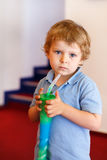 Little boy drinking colorful frozen slush ice Royalty Free Stock Photography