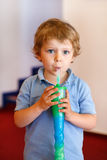 Little boy drinking colorful frozen slush ice Stock Photography