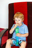 Little boy drinking colorful frozen slush ice Stock Photo