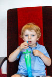 Little boy drinking colorful frozen slush ice Stock Image