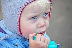 Little boy drinking Stock Images