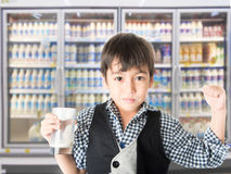 Little boy drinking fresh milk for healthy background of UHT milk storage Stock Photography