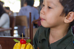 Little boy is drinking Stock Images
