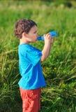 Little boy drinking gas water Stock Image
