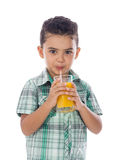 Little Boy Drinking A Glass of Juice royalty free stock image