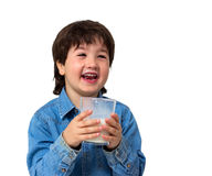 Little boy drinking a glass of milk Stock Photo