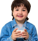 Little boy drinking a glass of milk Stock Images