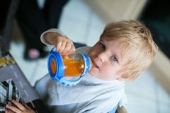 Little boy drinking juice Royalty Free Stock Photos