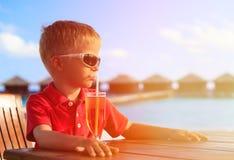 Little boy drinking juice on tropical resort Royalty Free Stock Photo