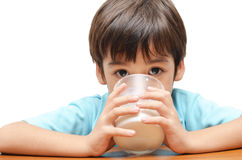 Little boy drinking milk close up Stock Image