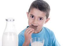 Little boy drinking milk and cookies Royalty Free Stock Photo