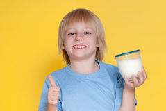 Little boy drinking milk Stock Photography