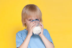 Little boy drinking milk Stock Photo