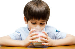 Little boy drinking milk isolated Royalty Free Stock Images