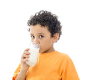 Little Boy Drinking Milk. Isolated on White Background royalty free stock photography