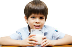 Little boy drinking milk with smiling isolated Stock Image