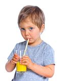 Little boy drinking orange juice Royalty Free Stock Photography