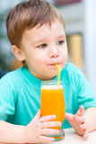 Little boy with glass of orange juice Royalty Free Stock Photography