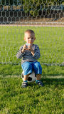 Little boy drinking while playing soccer Royalty Free Stock Photography