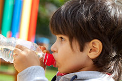 Little boy drinking pure water Stock Photography