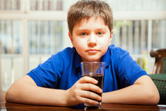 Little boy drinking soda Stock Photography