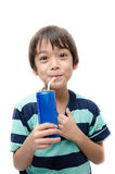 Little boy drinking soft drink can on white background Royalty Free Stock Images