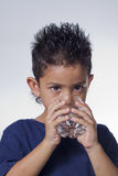 Little boy drinking water. On white background Royalty Free Stock Photos