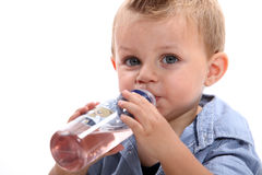 Little boy drinking water. From a bottle royalty free stock images