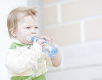 Little boy drinking water Royalty Free Stock Image