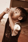 Little boy drinking water vintage tone Royalty Free Stock Photos