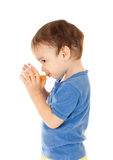 Little boy drinks apple juice from glass isolated Stock Images