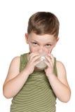 Little boy drinks milk Stock Image