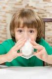Little boy drinks milk Royalty Free Stock Photo