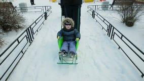 Little boy driven sledge winter stock video footage