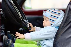 Little boy at driver seat Royalty Free Stock Images