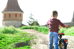 A little boy drives a bicycle Stock Image