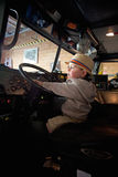 Little boy drives firetruck Stock Photos
